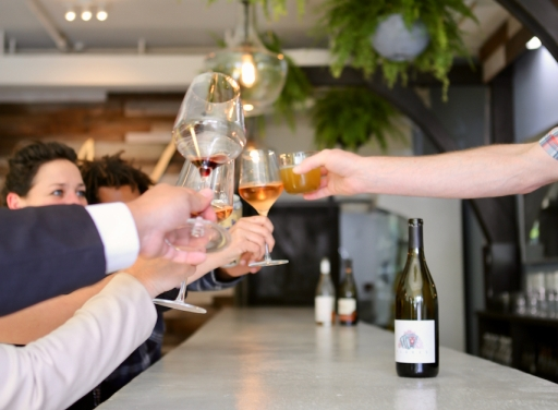 Photo of people toasting with wine glasses